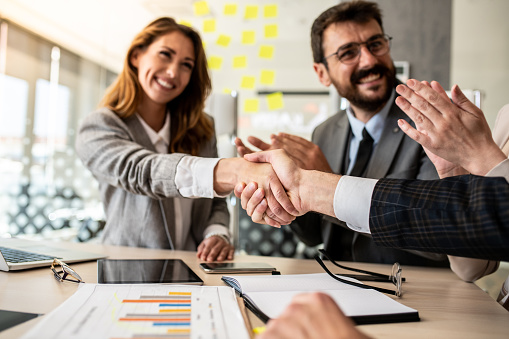 656005826 istock photo Business people shaking hands, finishing up meeting 1227245816