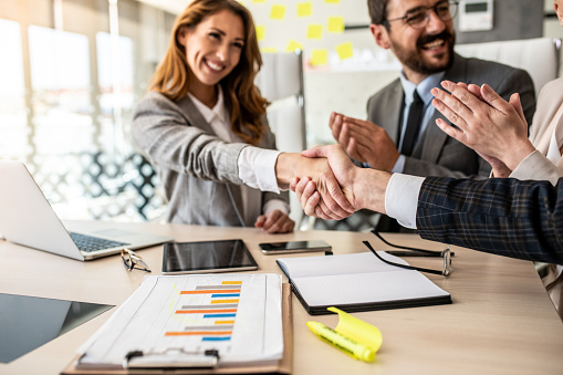 656005826 istock photo Business people shaking hands, finishing up meeting 1227245822
