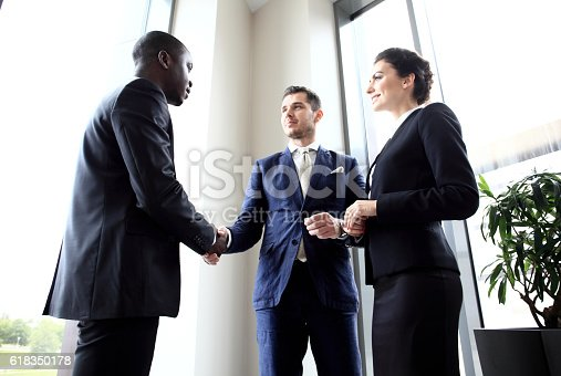 656005826istockphoto Business people shaking hands, finishing up meeting 618350178