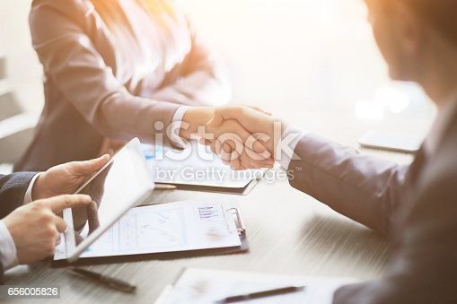istock Business people shaking hands, finishing up a meeting 656005826
