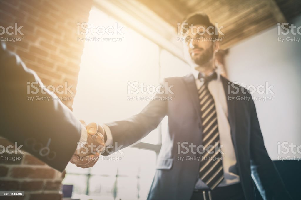Business people shaking hands. Finishing up meeting. – zdjęcie