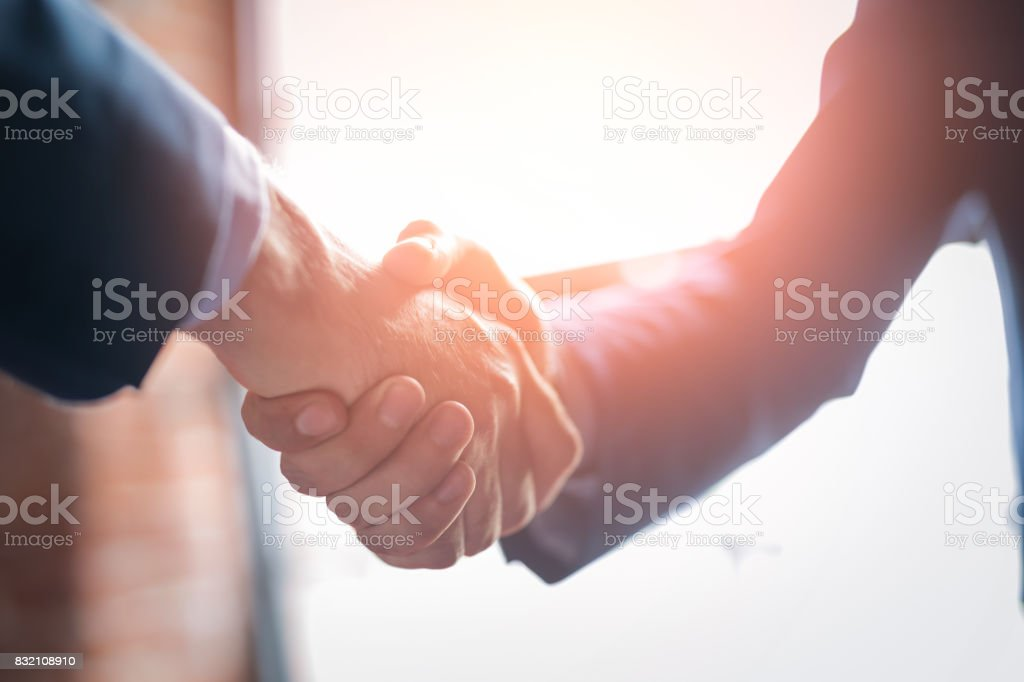 Business people shaking hands. Finishing up meeting. stock photo