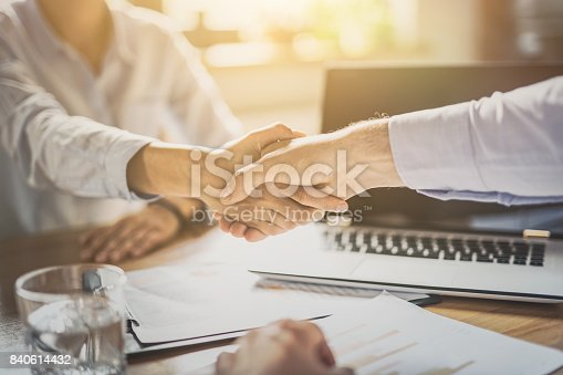 istock Business people shaking hands. Finishing up meeting. 840614432