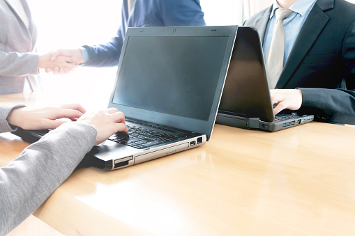 656005826 istock photo Business people shaking hands, finishing up meeting 868125688