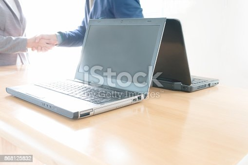 656005826istockphoto Business people shaking hands, finishing up meeting 868125832