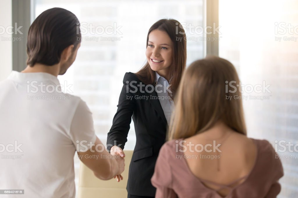 Business people shaking hands, greeting handshake with clients at office stock photo