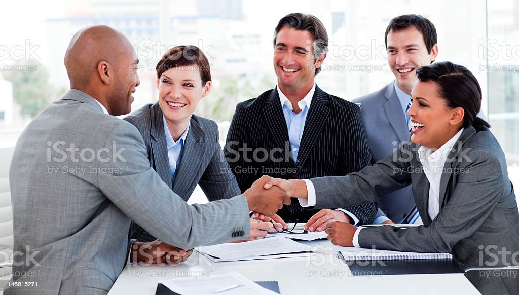 Business people shaking hands hello royalty-free stock photo