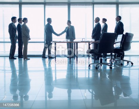 istock Business people shaking hands in conference room 147205356