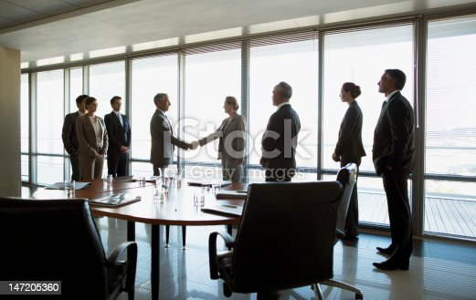 istock Business people shaking hands in conference room 147205360
