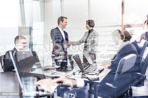 istock Business people shaking hands in moder corporate office. 640165402
