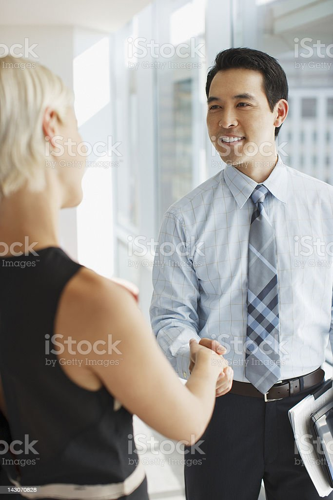 Business people shaking hands in office royalty-free stock photo
