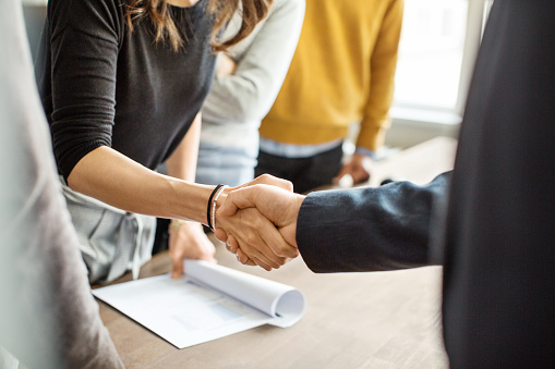istock Business people shaking hands in office 973715182