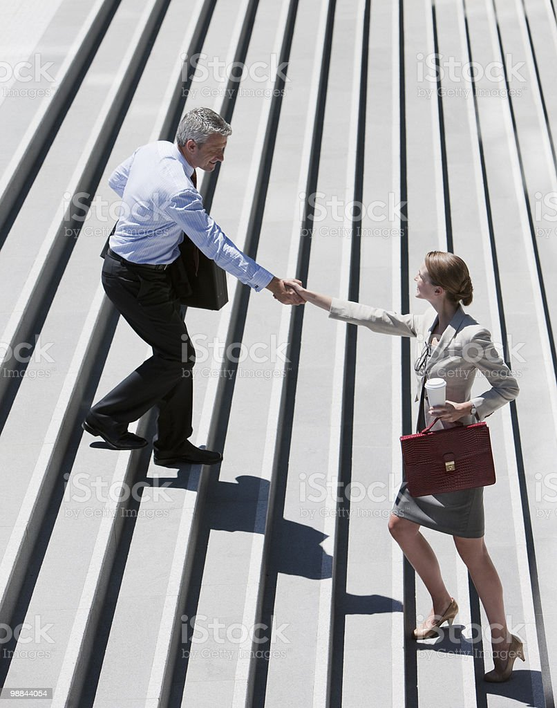 Business people shaking hands on steps outdoors 免版稅 stock photo
