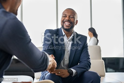 istock Business people shaking hands 1189302240