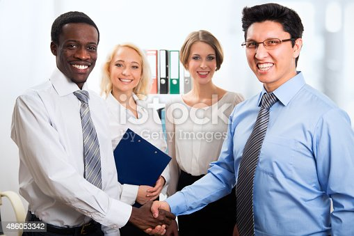 656005826istockphoto Business people shaking hands 486053342