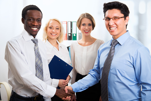 656005826 istock photo Business people shaking hands 486053342