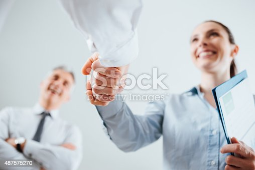 istock Business people shaking hands 487575270