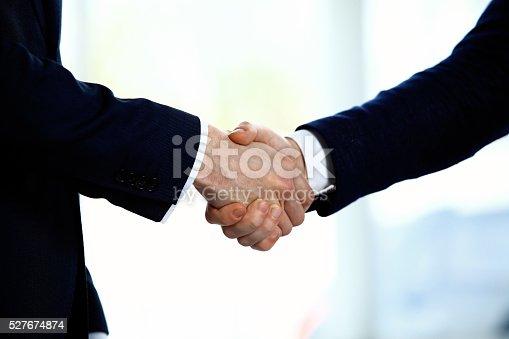 656005826istockphoto Business people shaking hands 527674874