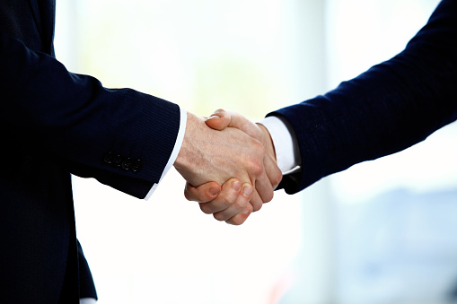 656005826 istock photo Business people shaking hands 527674874