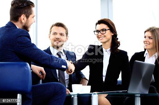 656005826istockphoto Business people shaking hands 612477724