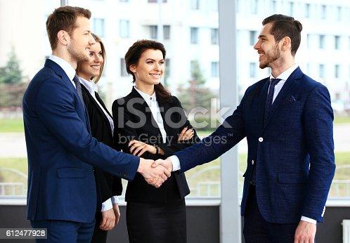 656005826istockphoto Business people shaking hands 612477928