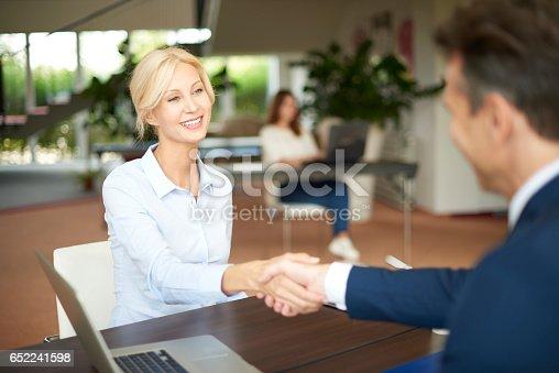 istock Business people shaking hands 652241598