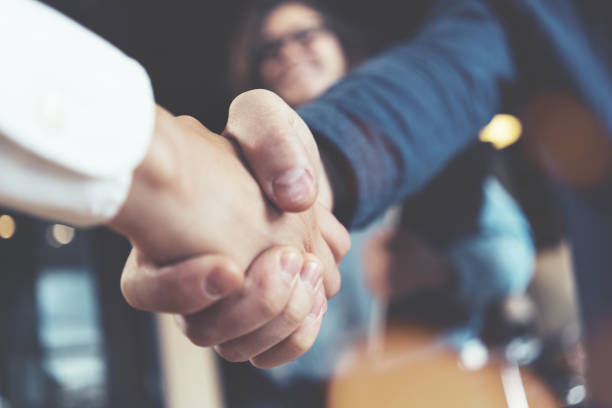 business people shaking hands - handshake stock pictures, royalty-free photos & images