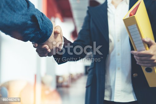 Business people shaking hands. Two managers after successful partnership