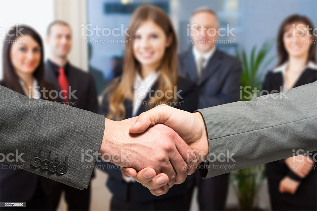 Business people shaking their hands stock photo