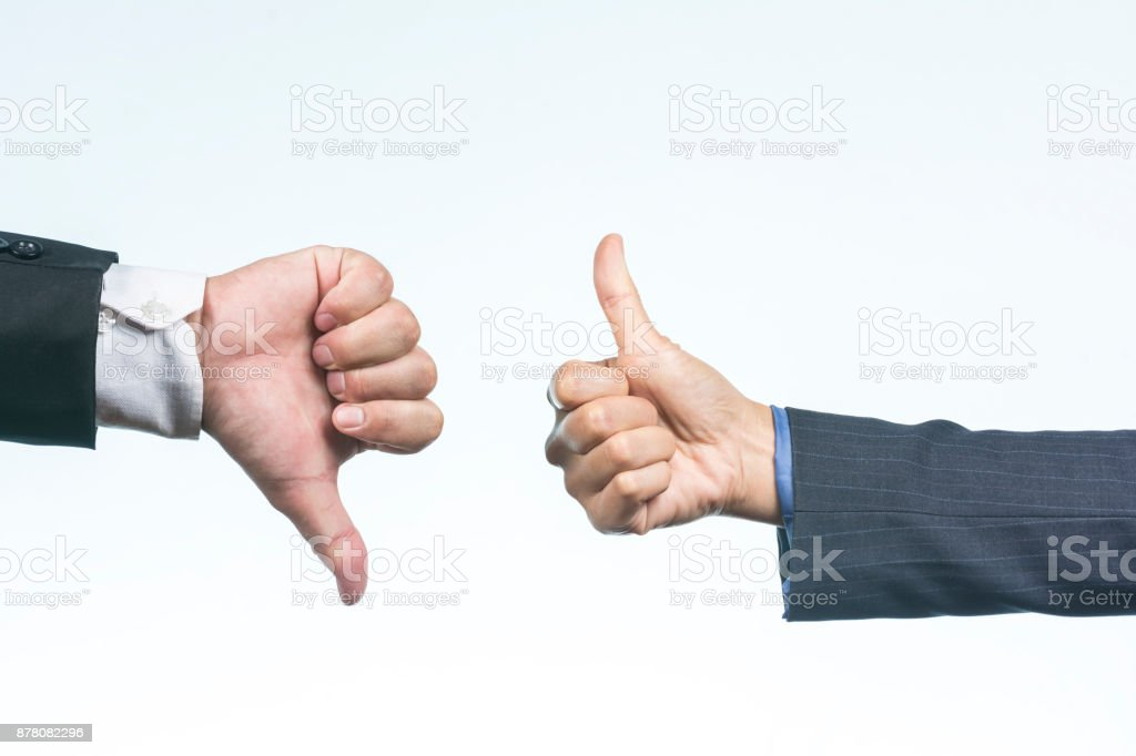 Business People Showing Thumbs up and Thumbs  down sign against on Isolate White Background. stock photo