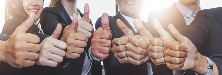 Business People Showing Thumbs Up For Teamwork And Together Concept Stock Photo - Download Image Now