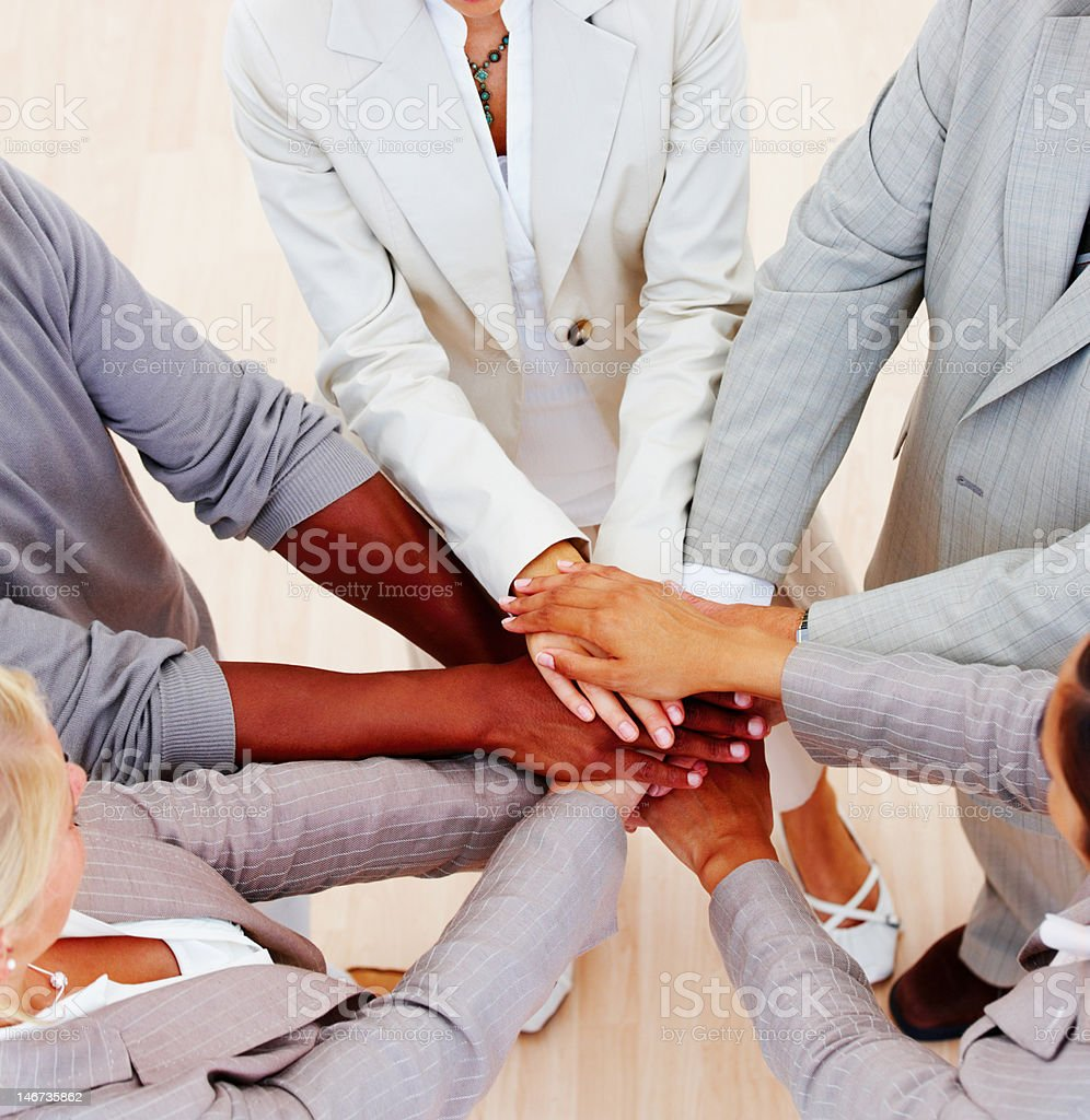 Business people showing unity stock photo