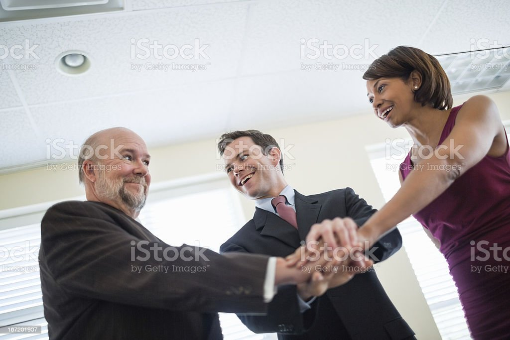 Business People Showing Unity With Hands Together royalty-free stock photo