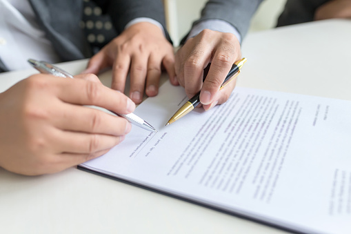 843533912 istock photo Business people, signing a contract, meeting together at a meeting. 1189568242