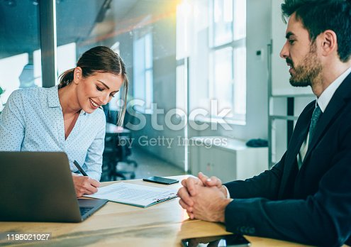 995734014istockphoto Business people signing a contract. 1195021027