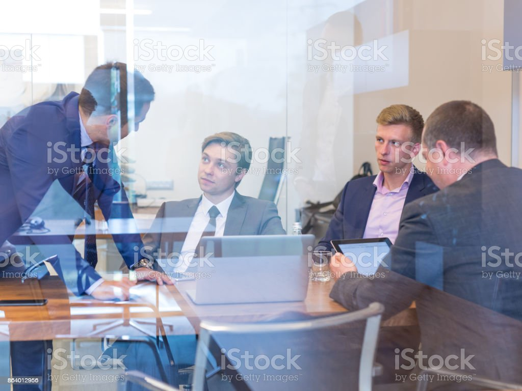 Business people sitting and brainstorming at corporate meeting. stock photo