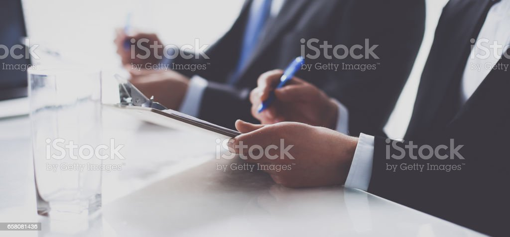 Business people sitting and discussing at business meeting, in office royalty-free stock photo