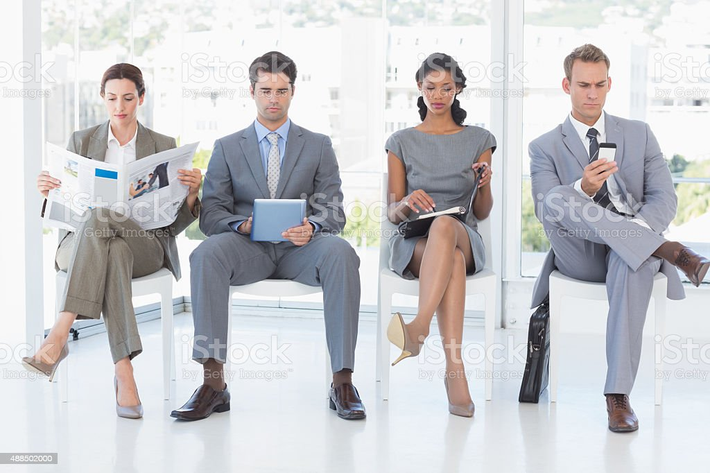 Business people sitting and waiting stock photo