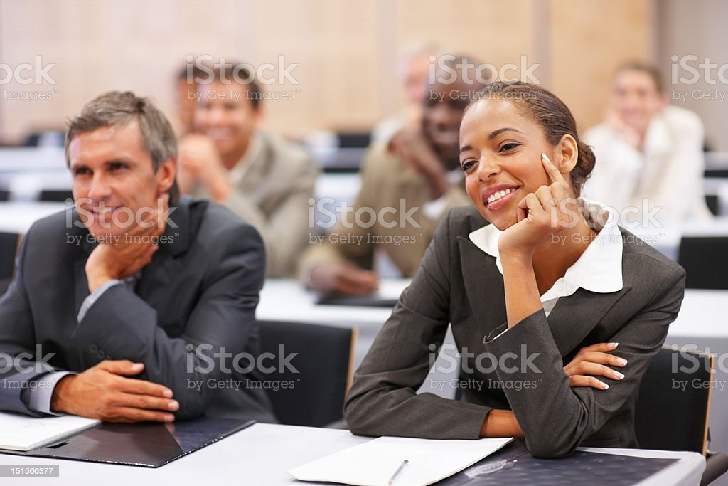 Business people sitting at the seminar royalty-free stock photo