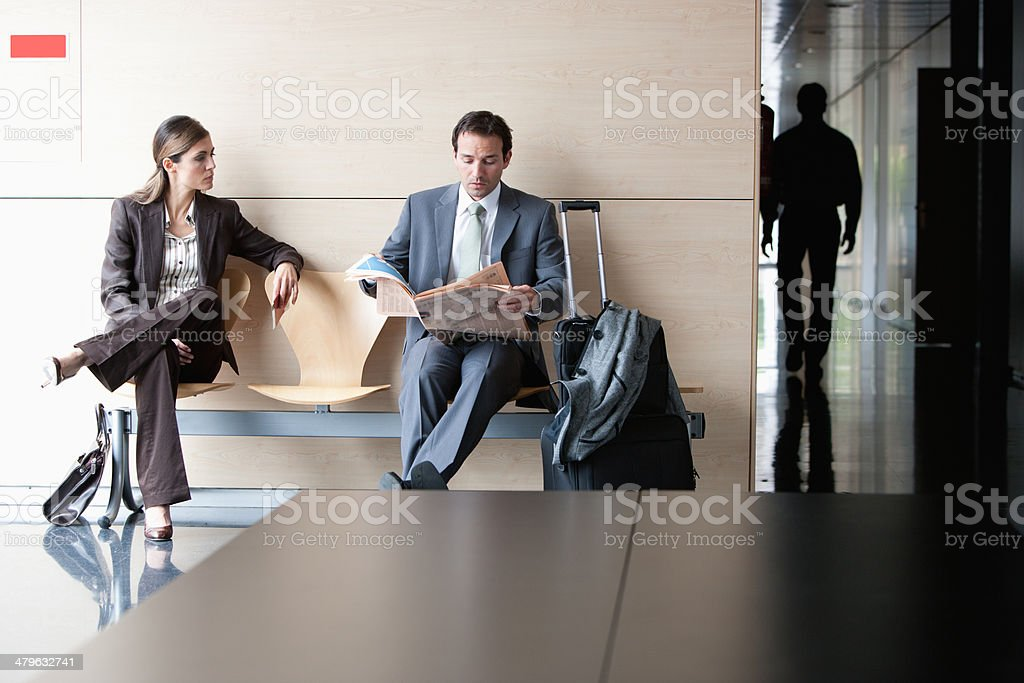 Business people sitting in waiting area stock photo