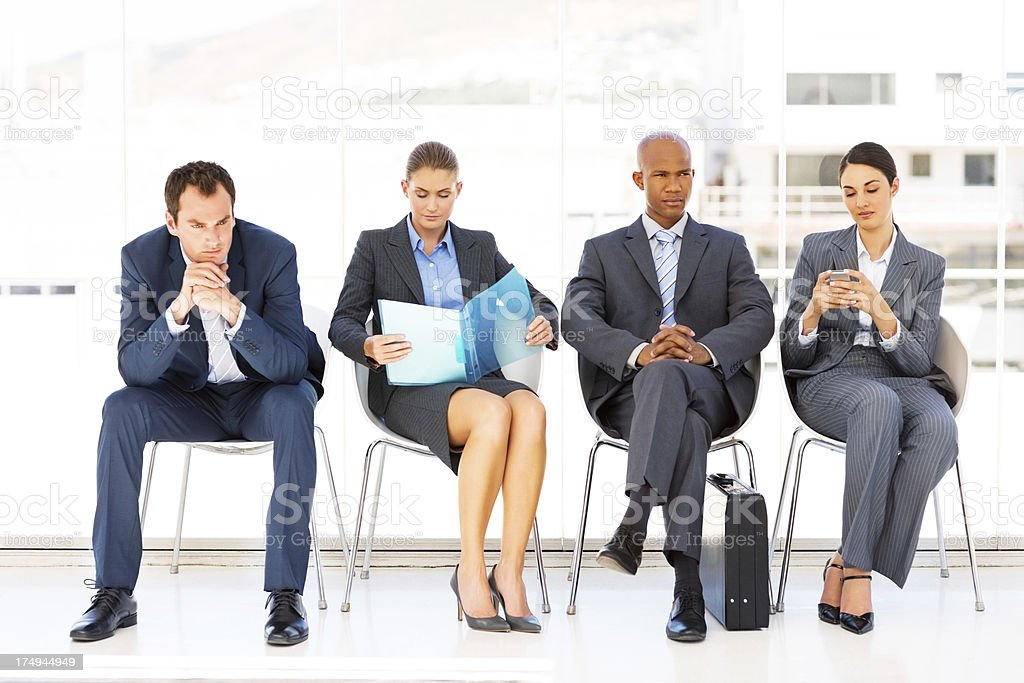 Business People Sitting In Waiting Room stock photo