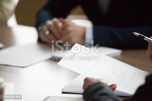 istock Business people sitting office desk at meeting 1050287402