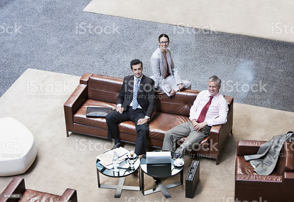 Business people sitting on sofa in lobby royalty-free stock photo
