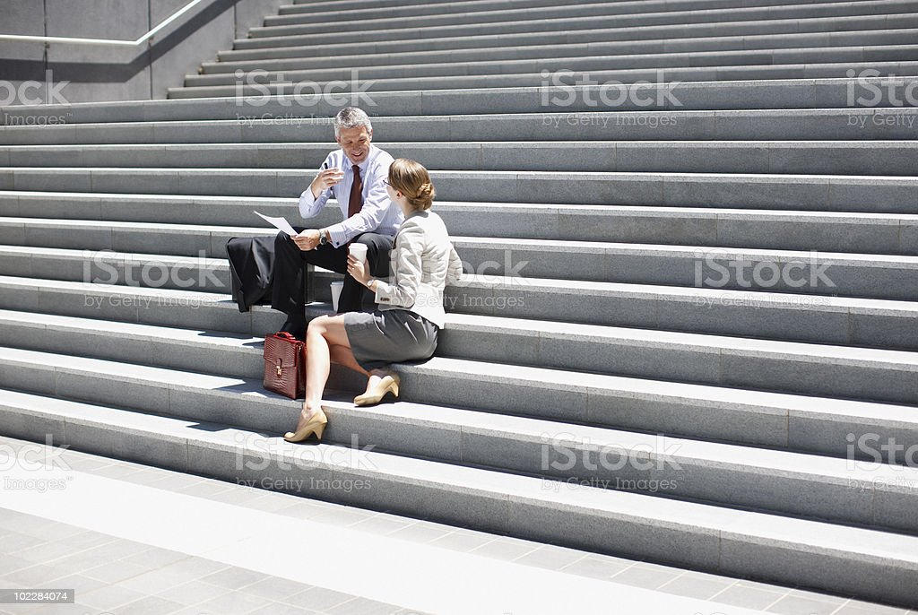 Business people sitting on stairs royalty-free stock photo