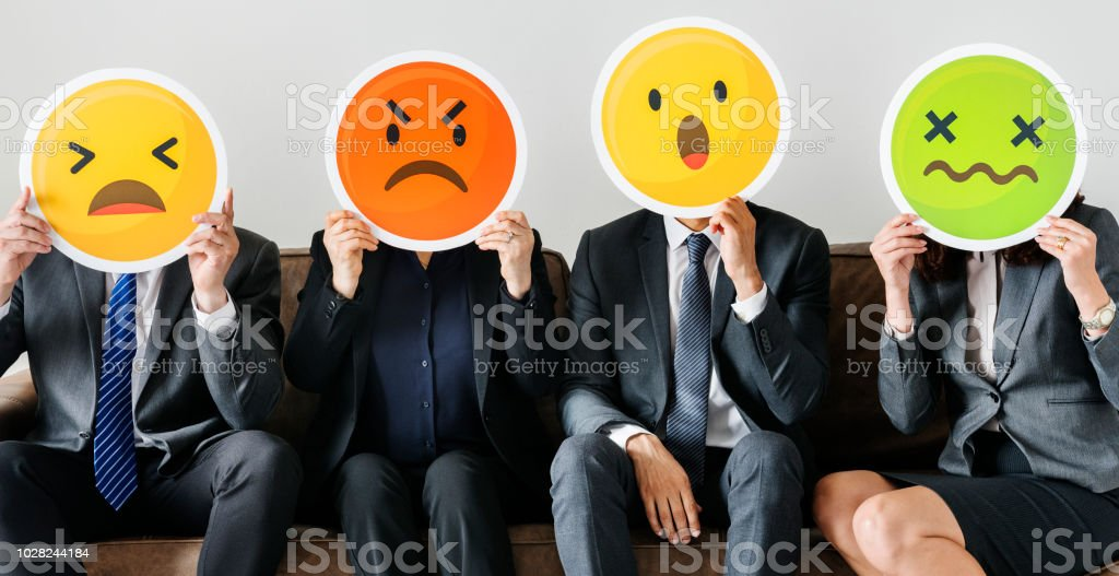 Business people sitting together with icons stock photo