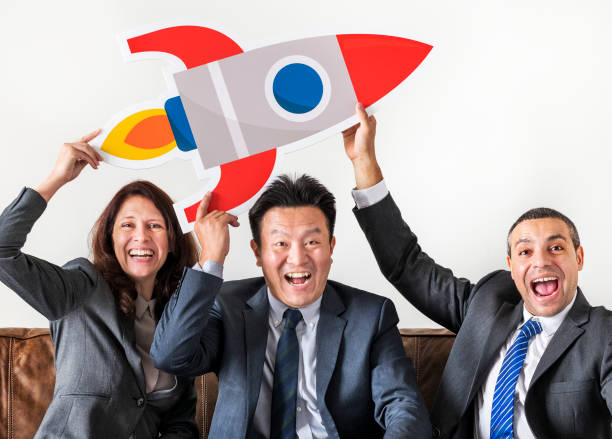 business people sitting together with icons - rocket logo stock photos and pictures