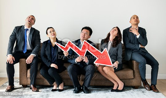 istock Business people sitting together with statistics icon 1011900240