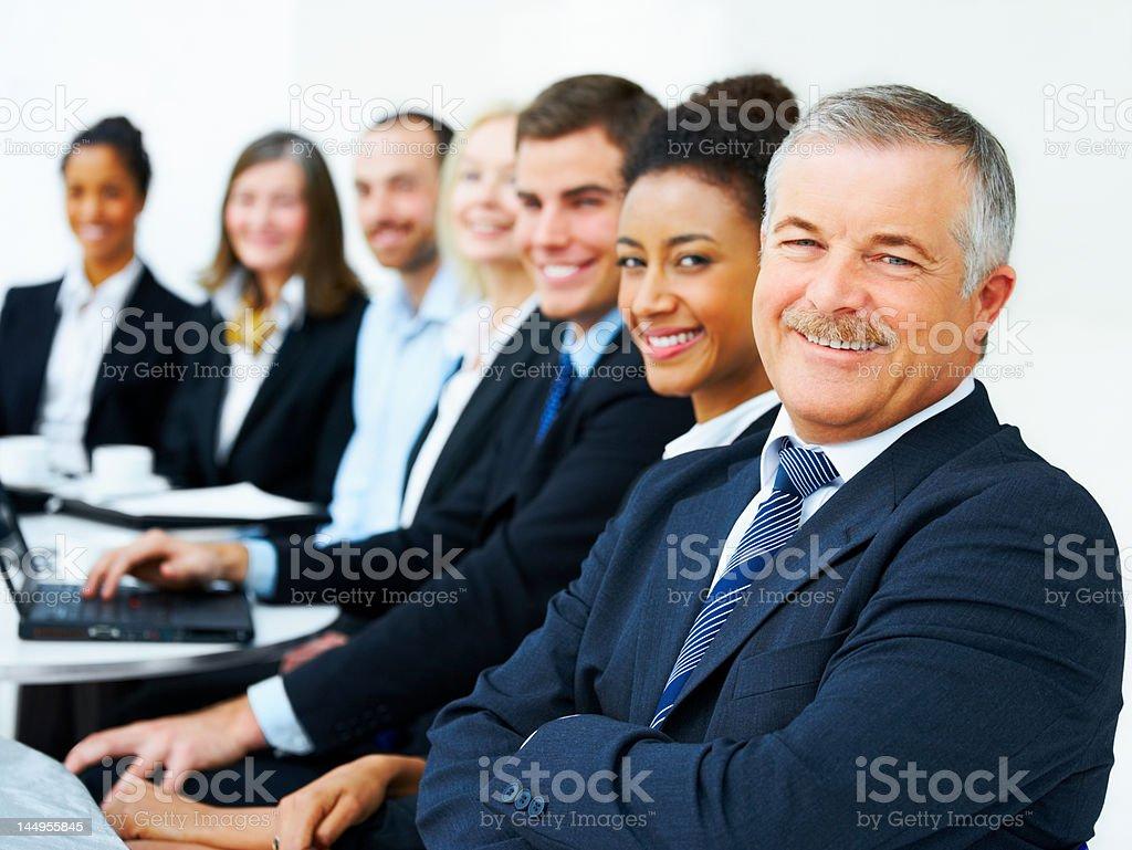 Lächelnd Geschäftsleute in einem meeting Lizenzfreies stock-foto