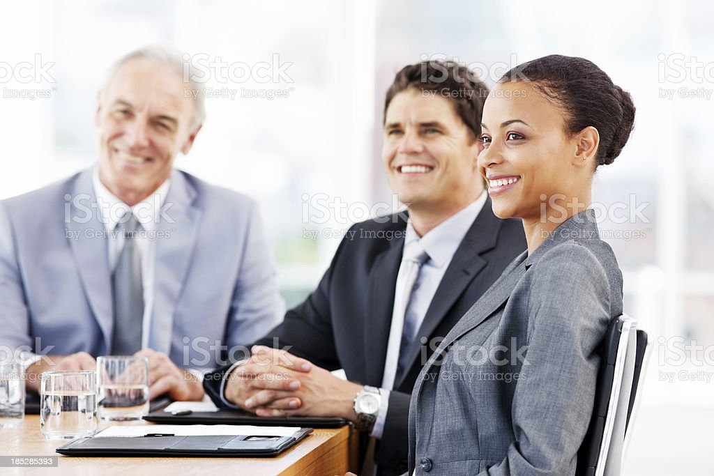 Business People Smiling In a Meeting royalty-free stock photo