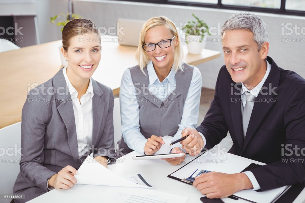 Business people smiling while sitting with client royalty-free stock photo